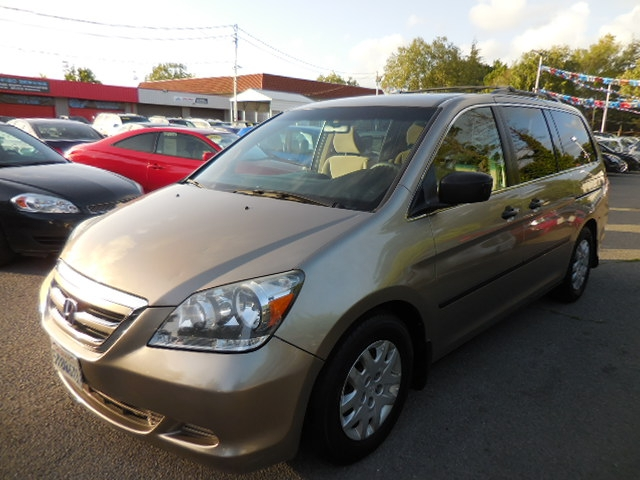 2007 Honda Odyssey LX Now offering a wonderful 2007 Honda Odyssey LX with low miles that is Gold i