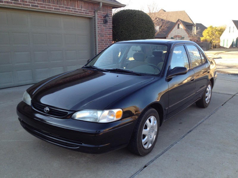 1999 toyota corolla ce sedan black extremely fule. Black Bedroom Furniture Sets. Home Design Ideas