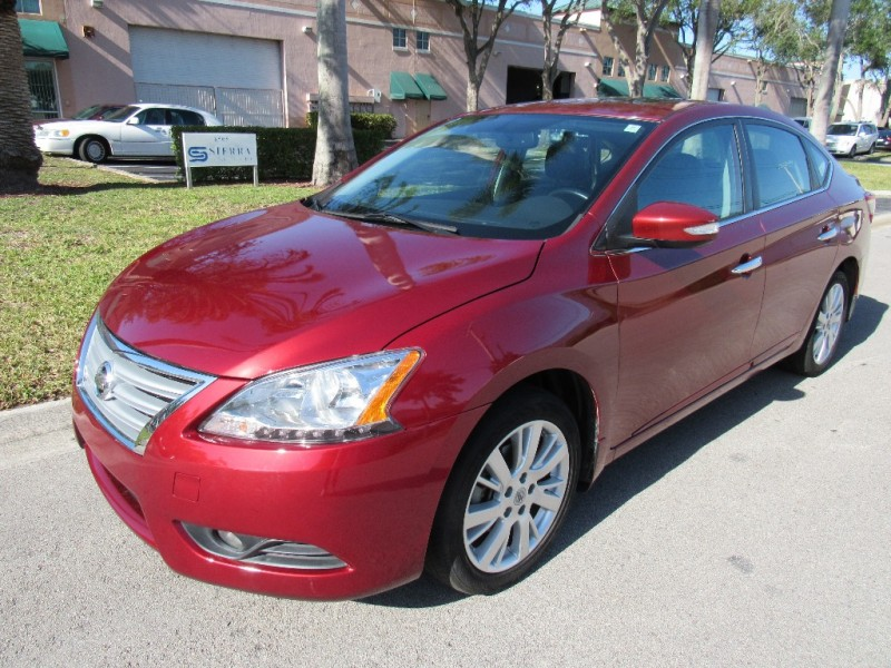 2015 Nissan Sentra 4dr Sdn I4 CVT SV Beautiful vehicle very clean in and out Red Black 49302