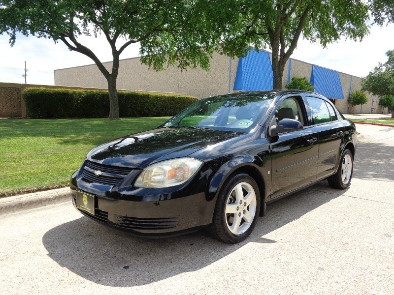 2009 Chevrolet Cobalt WWWDALLASPREOWNEDCOM Black Gray 62034 miles Stock 290473 VIN 1G1AT58H
