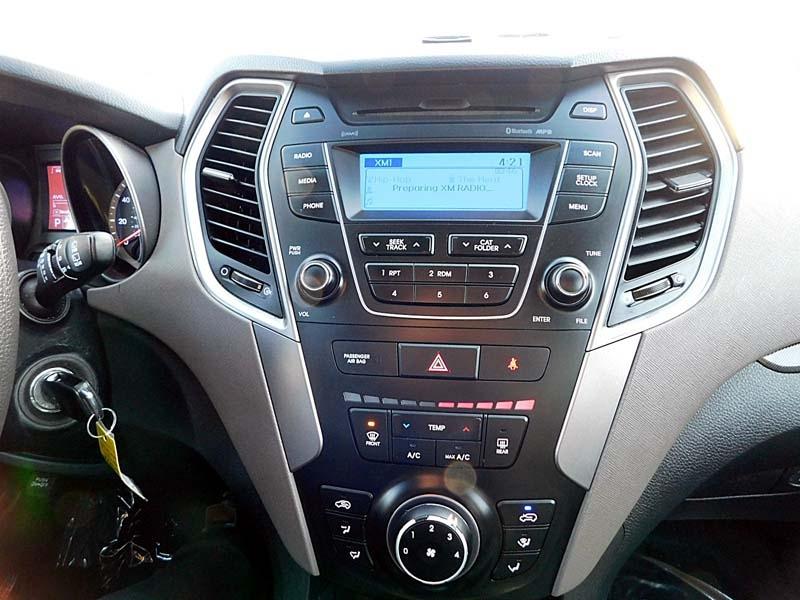 Hyundai Santa Fe 2015 price $12,600