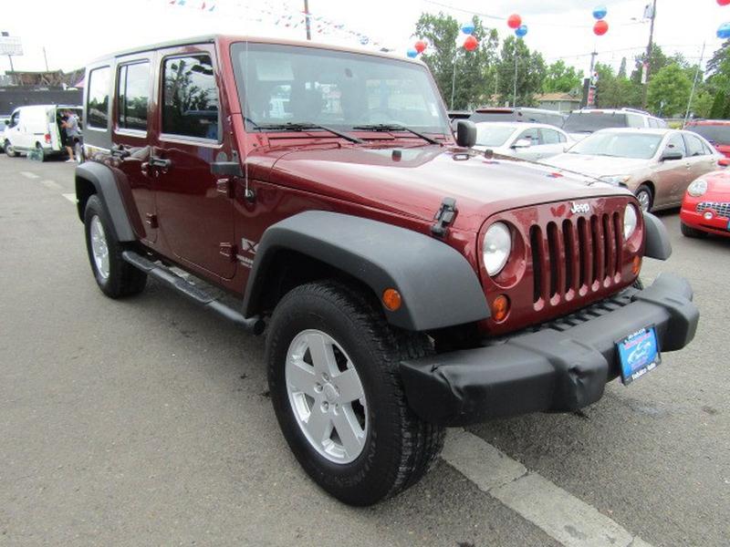 Jeep Wrangler Unlimited 2009 price $13,977