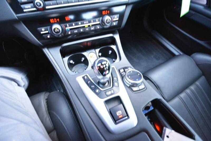 BMW M5 2014 price $49,990