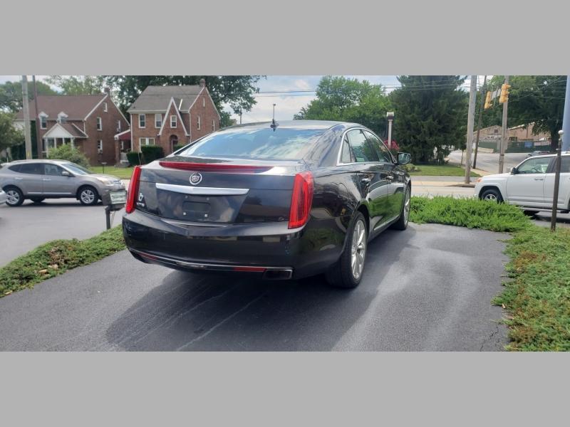 Cadillac XTS 2013 price $13,500