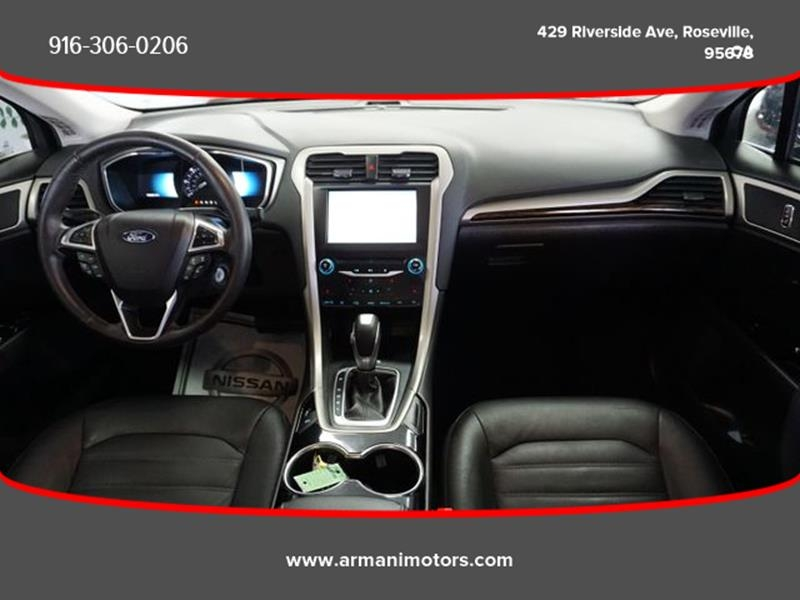 Ford Fusion Hybrid 2015 price $9,995