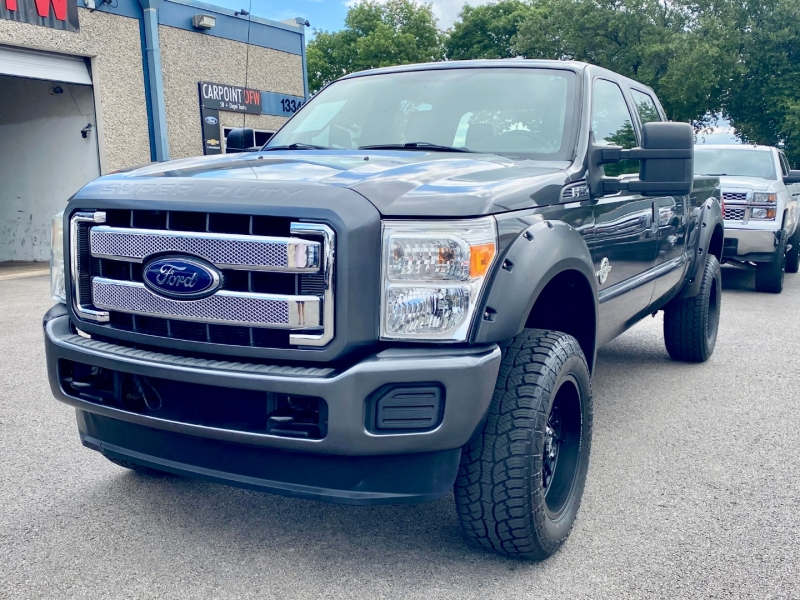 Ford F250 4X4 DIESEL. ~~ LIFTED ~~ 2015 price $27,995