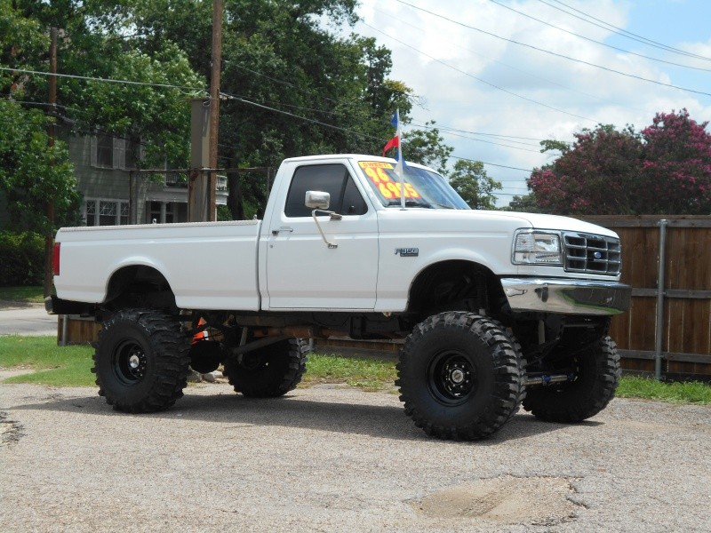 Old Jacked Up Trucks >> JACKED UP 96' FORD F350 SITTING ON 39'S - Inventory | Trucks Unlimited | Auto dealership in ...