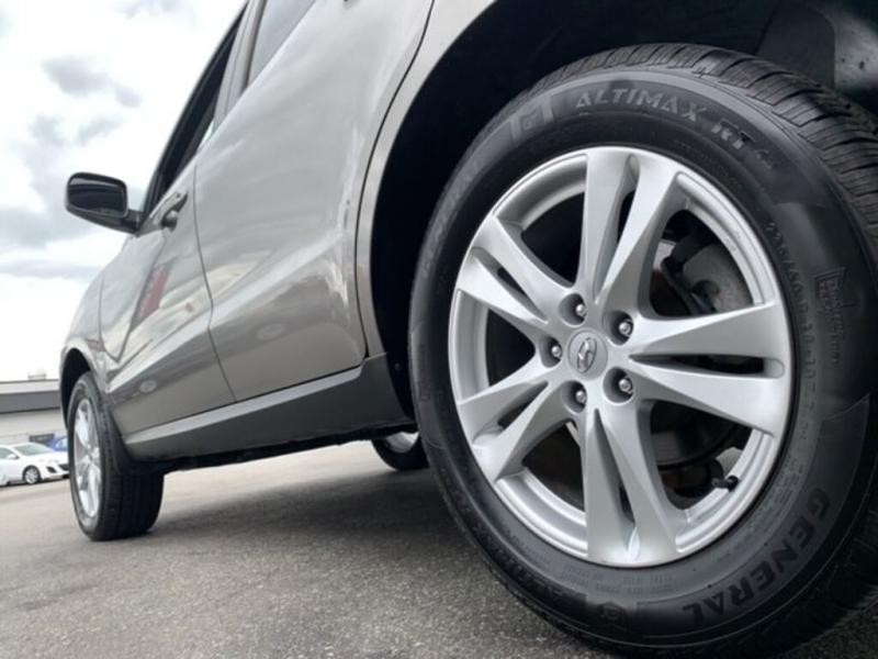 Hyundai Santa Fe 2012 price $12,888