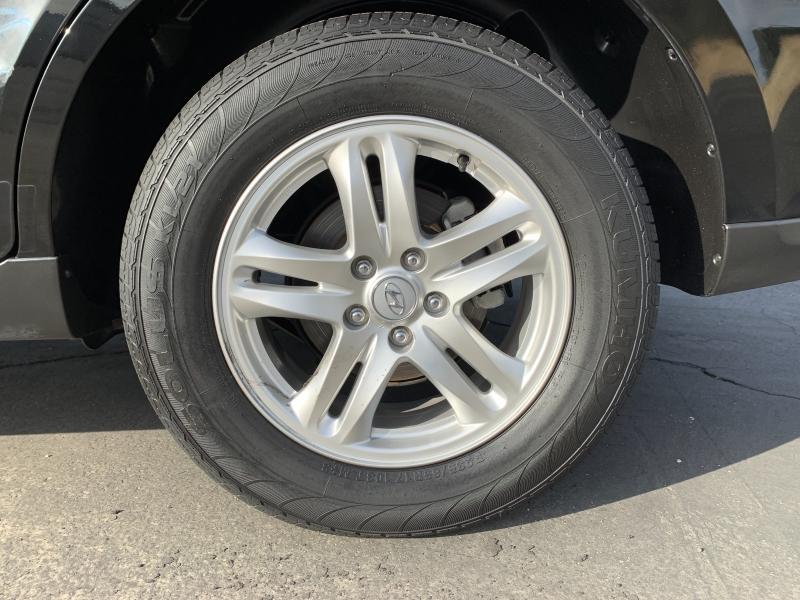 Hyundai Santa Fe 2012 price $9,988