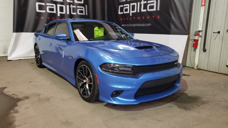 Dodge Charger 2015 price $25,990