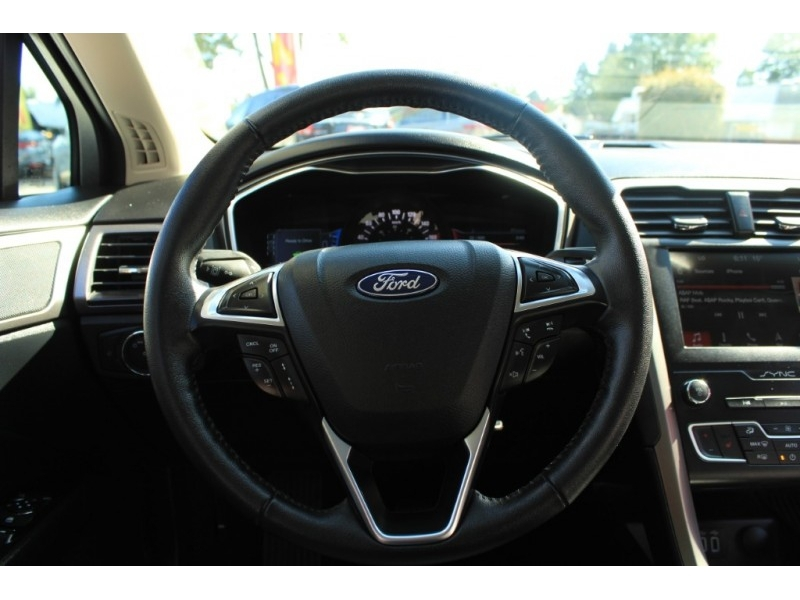 Ford Fusion Hybrid 2019 price $27,889